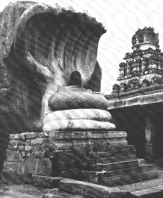 A Shiva lingam shaded by the seven-headed Naga-serpent, in the temple of the Nayak chiefs at Lepaskshi. Anantapur District, Andhra Pradesh State.
