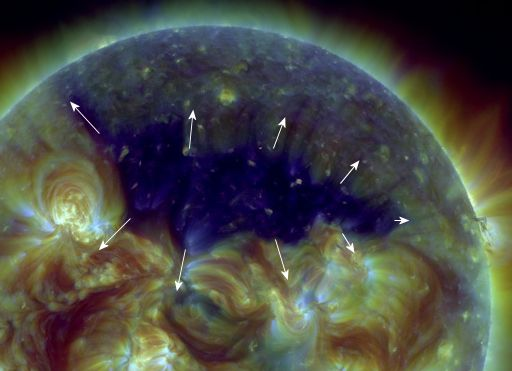 CORONAL HOLE: Opening up like a zipper almost a million kilometers long, a vast coronal hole has appeared in the sun's northern hemisphere. NASA's Solar Dynamics Observatory took this picture of the UV-dark chasm on July 18th